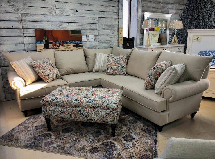 sectional furniture, ottoman, and rug