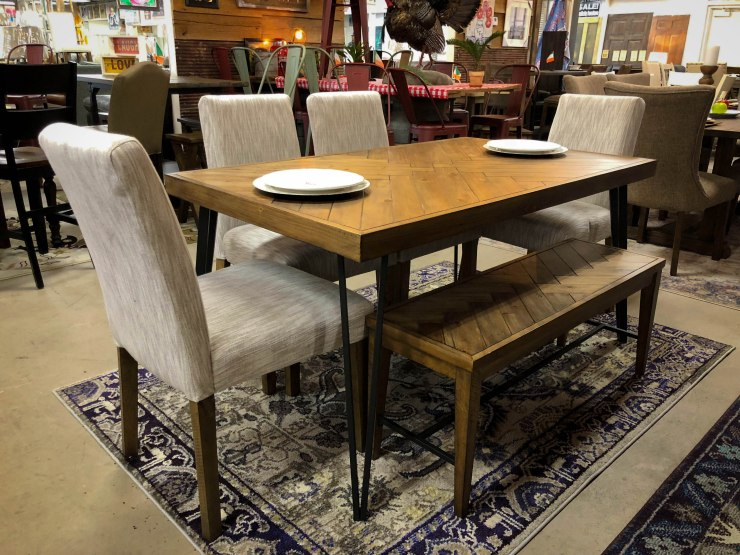 dining room table chairs bench on rug